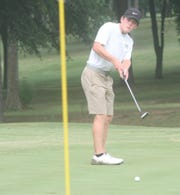 Mountain Home's Will Beckham watches his putt during recent action at Paragould.