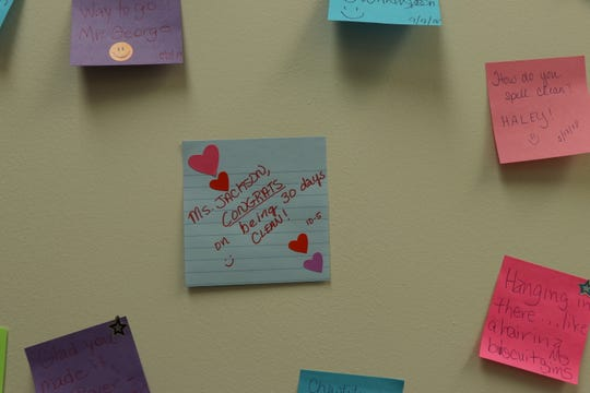 Participants in the Murfreesboro Day Reporting and Community Resource Center can write their triumphs on a slip of colorful paper and post it in the hallway.