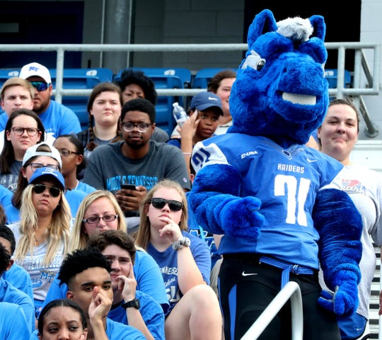 MTSU students and the MTSU mascot Lightning get ready to unveil the new Blue Zoo banner at Floyd Stadium in front of the MTSU football team on Tuesday Aug. 13, 2019.