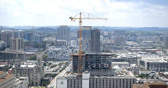 The Nashville Yards construction site is visible in downtown Nashville from the 30th floor of the Fifth + Broadway development on Wednesday, Aug. 7, 2019.