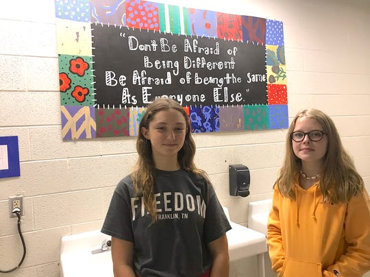 Madison Ward and Emma Wharton, eighth grade students, created a mural with a message for the girls bathroom at Freedom Middle School.