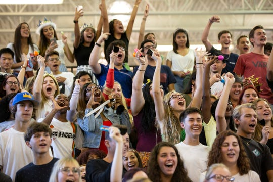 Students in Collier County cheer during a back-to-school pep rally on Tuesday, Aug. 13, 2019, at Naples High School.