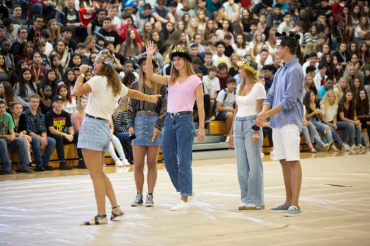 Fallon Jones, left, the public relations director of Naples High student government, introduces other members during a back-to-school pep rally on Tuesday, Aug. 13, 2019, at Naples High School.