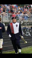 Braden Poling appears in his uniform as part of the Lakewood High School Lancer Marching Band.