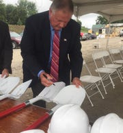 Etna Township Trustee John Carlisle and others signed shovels and hardhats used at the groundbreaking Aug. 13 for the 70 East Logistic Center.