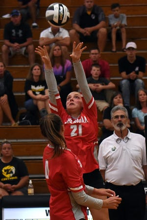 Sheridan's Kendyl Mick sets the ball during a scrimmage on Monday, against Watkins Memorial High School. Mick is one of several returning starters for the Generals.