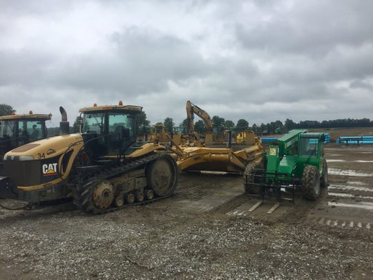 Some of the many pieces of heavy equipment already at work at the Mink Street site of the 1.2 million square foot structure to come.