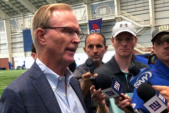 New York Giants co-owner John Mara talks to the media in East Rutherford, N.J., Tuesday, Aug. 13, 2019.