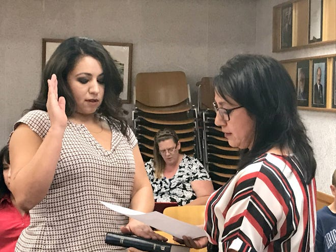 Appointed District 2 City Council member Irmaisela Rodriguez, left, is given the oath of office by executive secretary/assistant deputy clerk Lila Jasso.