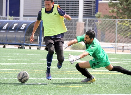 Deming Wildcat forward Cain Cisneros, left, beat the goal keeper on this breakaway to spot the Wildcats a 2-0 lead at half time of Saturday's scrimmage against the Deming Aztecas club team.