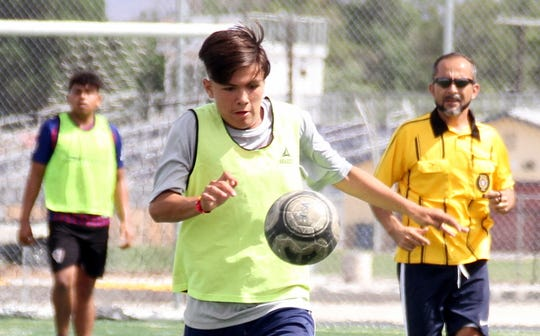 Sophomore Wildcat Aaron Nava chases down a free ball during Saturday's 2-2 tie with the Aztecas club team in Deming.