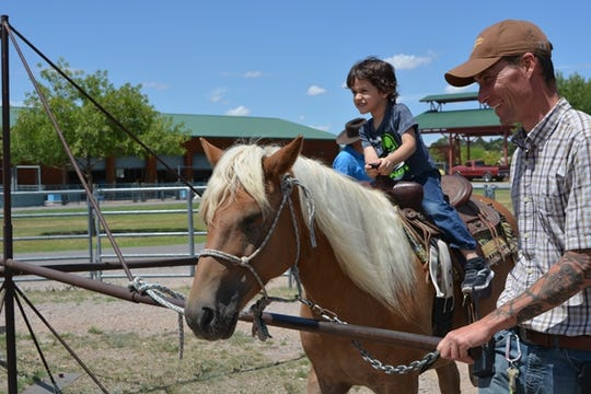 In this file photo, a child rides a pony at during Community Appreciation Day at the New Mexico Farm & Ranch Heritage Museum.
