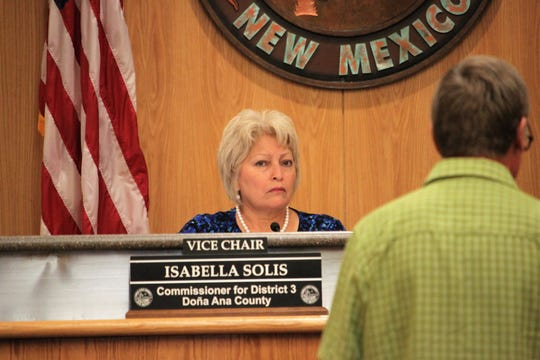 Doña Ana County Commissioner Isabella Solis listens as Kevin Bixby addresses commissioners during their meeting on Tuesday, August 13, 2019.