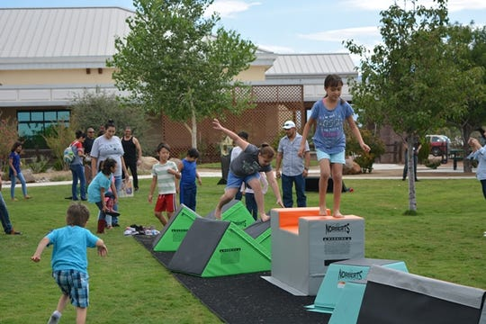 In this file photo, children play during Community Appreciation Day at the New Mexico Farm & Ranch Heritage Museum.