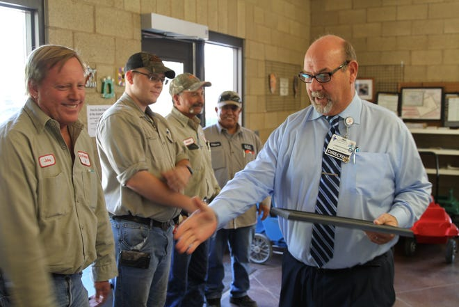 White Sands Beautification Committee Chair Christopher Hayman shakes the hands of zoo staff as the committee recognized Alameda Zoo for making exterior upgrades to the facility.