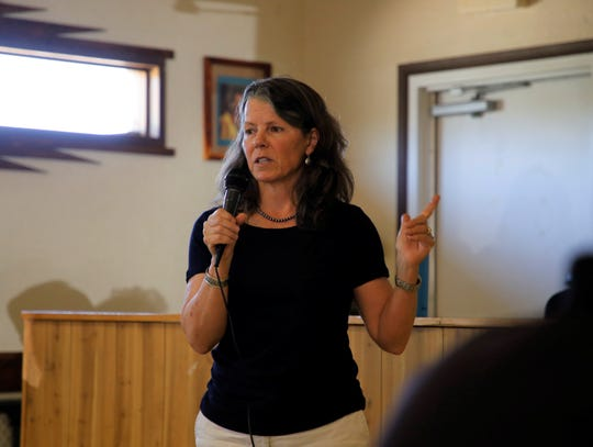 Sandra Ely, director for the New Mexico Environment Department's Environmental Protection Division, talks about the process to develop rules for methane emissions on Aug. 12 at the Counselor Chapter house.