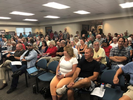 Lyon Township residents fill the room at a planning commission public hearing on the Cider Mill Village plan on Aug. 12, 2019.