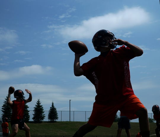Northville Mustang QBs Tyler Voss, right, and Tyler Patterson work in some throwing drills on Aug. 13.