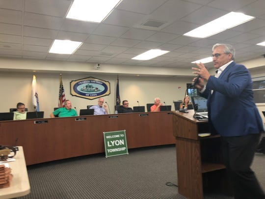 Howard Fingeroot, representing applicant Cider Mill Village of Lyon, LLC, speaks at a public hearing on a planned development for the current Erwin Orchards property on Aug. 12, 2019.