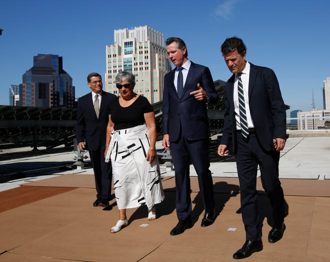 Gov. Gavin Newsom tours a solar panel installation with California Air Resources Board Chair Mary Nichols, Attorney General Xavier Becerra and California Environmental Protection Agency Secretary Jared Blumenfeld in 2019.