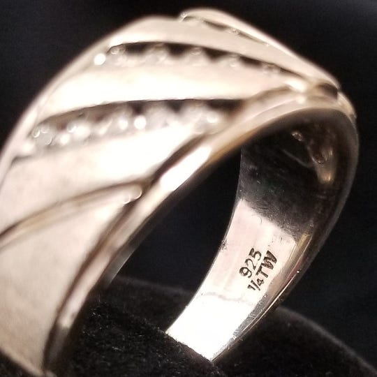 "A "".925"" mark indicates sterling silver on jewelry."
