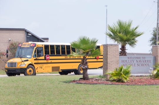 Santa Rosa County School District buses leave Holley-Navarre Middle School on Tuesday.