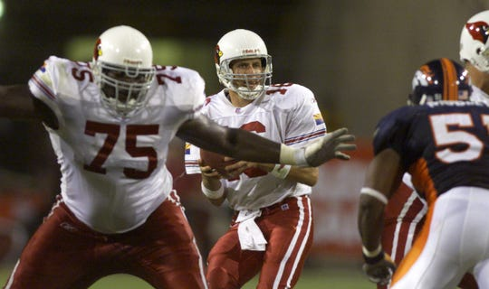 Cardinals offensive lineman Leonard Davis (75) protects quarterback Jake Plummer during a game against the Broncos on Sept. 23, 2001 at Sun Devil Stadium.