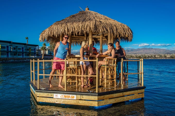 Cruisin' Tikis' floating tiki bar on Lake Havasu can hold up to six passengers and cruises through Bridgewater Channel beneath London Bridge.