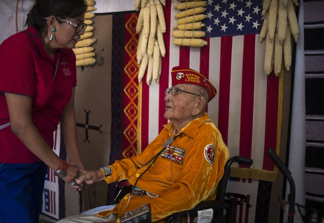 Shaylee Vandever talks with her grandfather Navajo Code Talker Joe Vandever Sr. on July 12, 2019, in their family's hogan in Haystack, New Mexico.