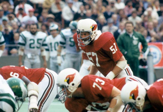 St. Louis Cardinals linebacker Mark Arneson (57) gets set before the snap during a game against the Philadelphia Eagles at Busch Stadium on Nov 20, 1977.