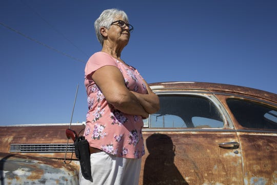 A portrait of Brenda Parkerson, Aug. 8, 2019, at her antique car shop, which is located across the road from proposed aluminum recycling and smelting facility, Wenden, Arizona.