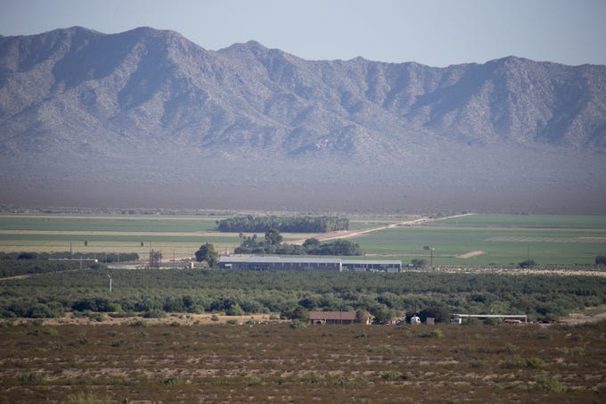 The site of the proposed aluminum recycling and smelting facility (center, gray building), Aug. 8, 2019, Wenden, Arizona.