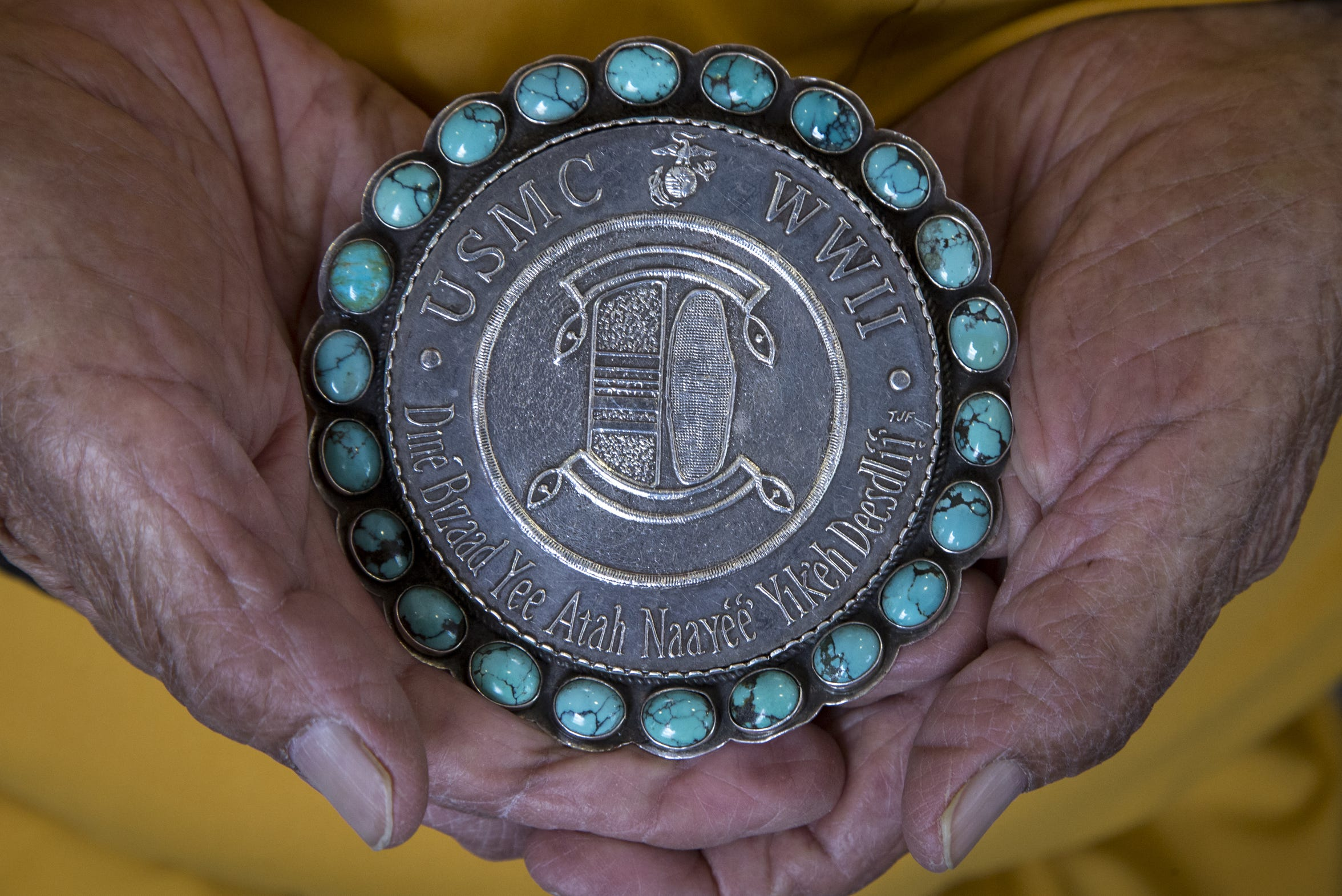 Navajo Code Talker Thomas H. Begay holds his Congressional Silver Medal on July 13, 2019, in Albuquerque, New Mexico.