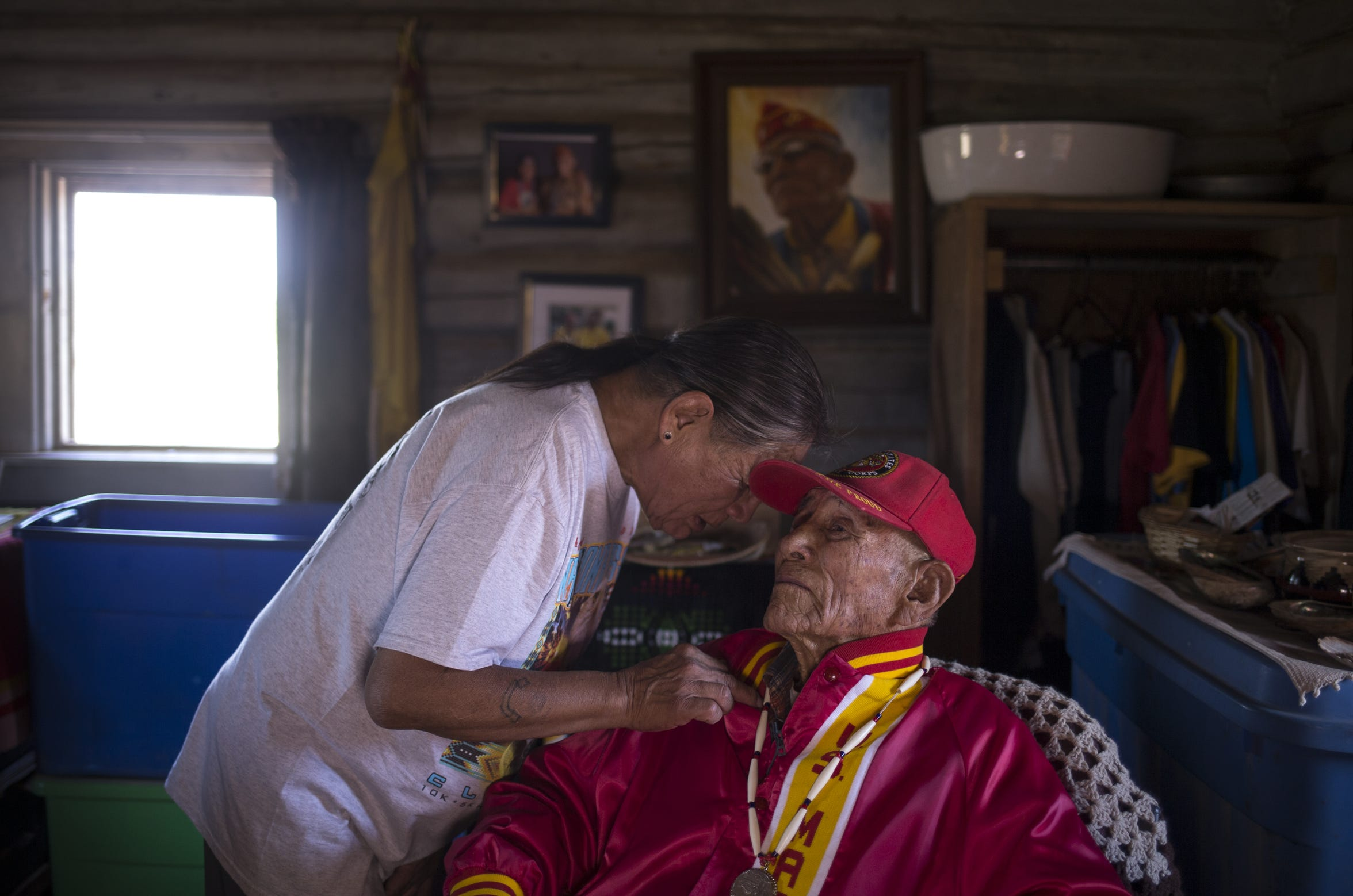 Ronald Kinsel talks with his father, Navajo Code Talker John Kinsel, Sr. on July 11, 2019, at their home in Lukachukai, Arizona.