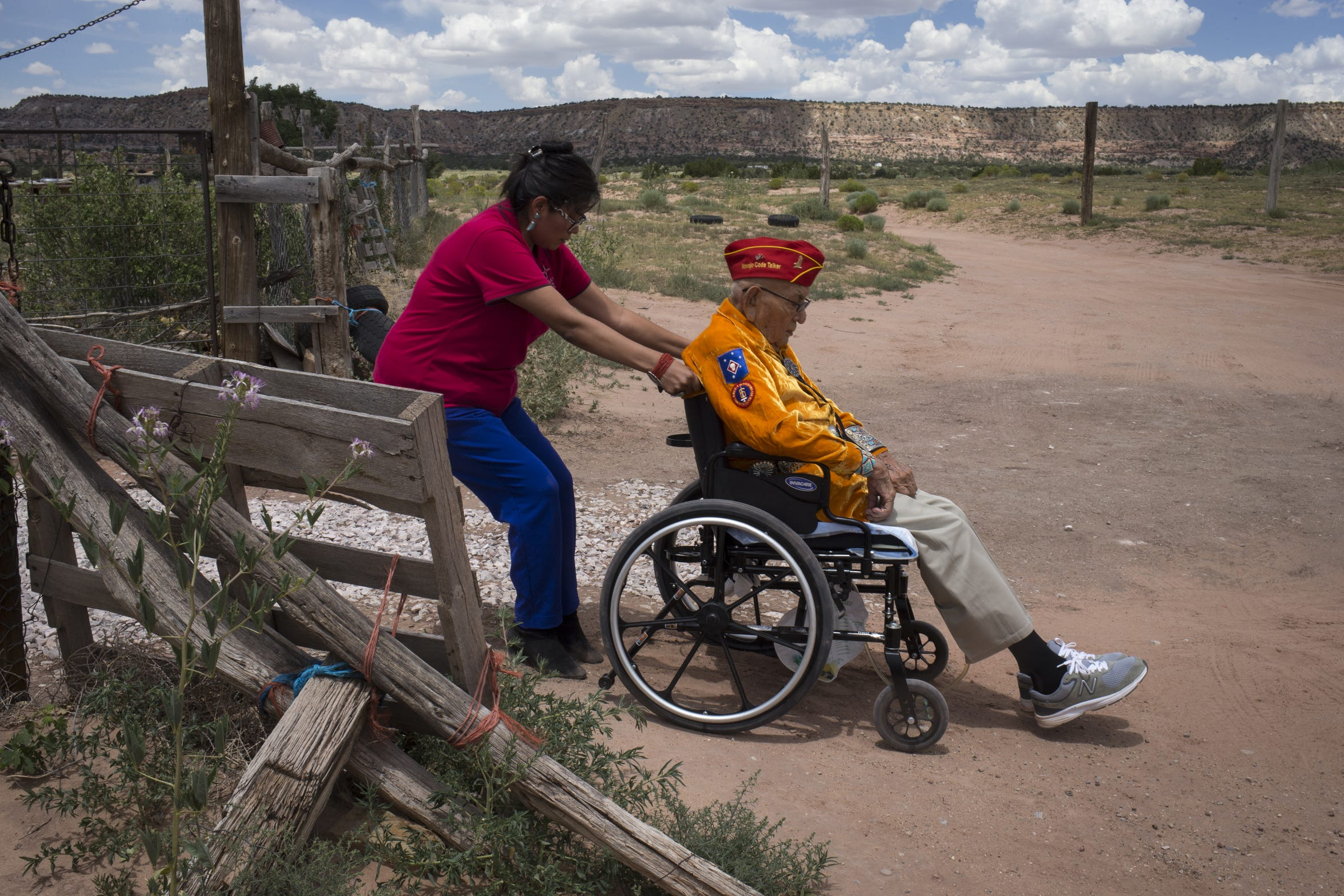 Shaylee Vandever pulls her grandfather, Navajo Code Talker Joe Vandever Sr. up the driveway on July 12, 2019, at their home in Haystack, New Mexico.