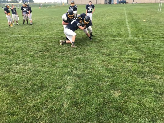 Elco players work on double team blocking during a recent practice in Myerstown.