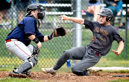 Viking's Anthony Kahley beats a throw to home with Manchester catcher Spencer Rhoads covering during Central League playoff action at Sunset Lane Park Tuesday, Aug. 13, 2019. Manchester went on to win 7-3. Bill Kalina photo