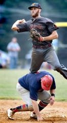 Manchester runner Matt Jordan breaks up a double play with Viking shortstop Brock Gladfelter making the relay during Central League playoff action at Sunset Lane Park Tuesday, Aug. 13, 2019. Manchester went on to win 7-3. Bill Kalina photo
