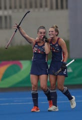 Central York High School graduate Lauren Moyer, right, celebrates with teammate Erin Matson after the United States' victory over Chile in the women's field hockey bronze-medal match at the Pan American Games in Lima, Peru, Friday, Aug. 9, 2019. Both players scored during the game. (AP Photo/Silvia Izquierdo)