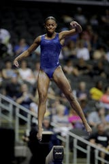 West York's Trinity Thomas works on the beam during practice for the senior women's competition at the 2019 U.S. Gymnastics Championships Friday, Aug. 9, 2019, in Kansas City, Mo. (AP Photo/Charlie Riedel)