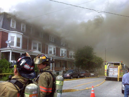 Firefighters work to put out a fire in the 700 block of Chestnut Street in York on Wednesday, July 8, 2009.