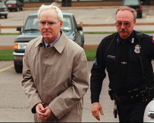 Rev. William Lum under arrest, 1997