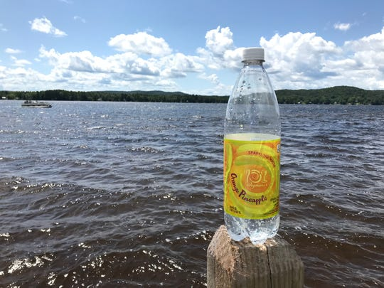 Wegmans Orange Pineapple seltzer, enjoyed on the shores of West Caroga Lake, fueled much of the wedding weekend for beer columnist Will Cleveland.