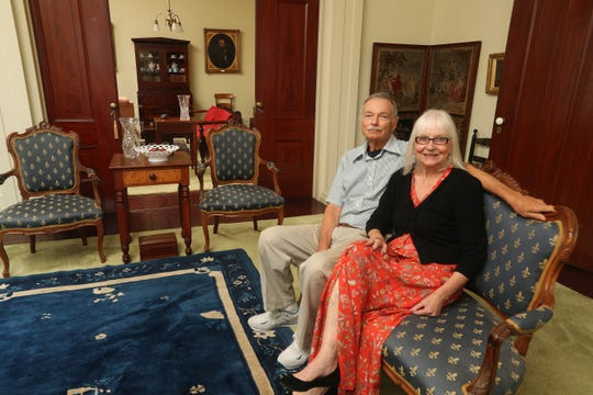 James and Judien Cooper in one of the sitting areas that opens to another room through pocket doors.