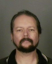 Rev. Dennis Sewar booking photo, 2005