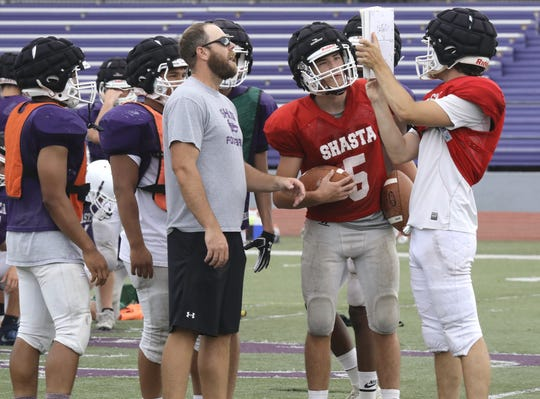 The Shasta Wolves' varsity football team practices Friday, Aug. 9, 2019, with head football coach J.C. Hunsaker.