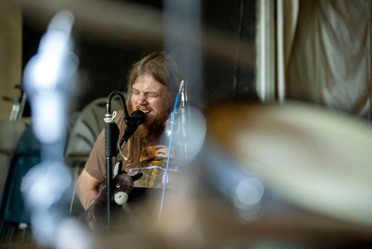 Johnny Kennicott's is on vocals and the harmonica as his band Johnny Wheels and the Swamp Donkeys band practices August 6, 2019, in Sheridan, Oregon. The band will represent the Cascade Blues Association at the 2020 International Blues Challenge in Memphis. Kennicott sings and plays the harmonica, both challenging because he has a partially paralyzed diaphragm from a childhood swimming/diving accident that left him in a wheelchair.