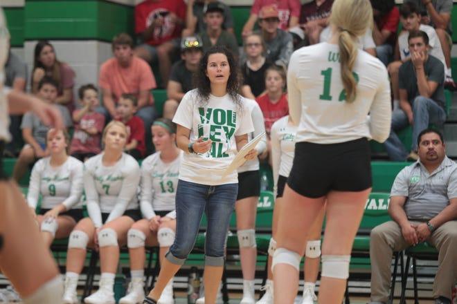 Wall High School volleyball coach Robynn Jones gives instructions to Lauren Scherr during a match Tuesday, Aug. 13, 2019 at Wall High School.