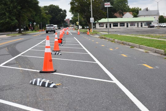 Cones sit between a new bike lane and vehicle traffic on Waverly Drive in Salisbury on Tuesday, Aug. 13, 2019.