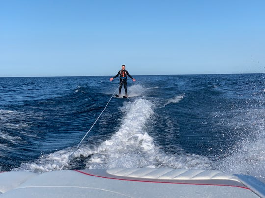 Braden Dirkse skis across Lake Michigan on Aug. 10, 2019.